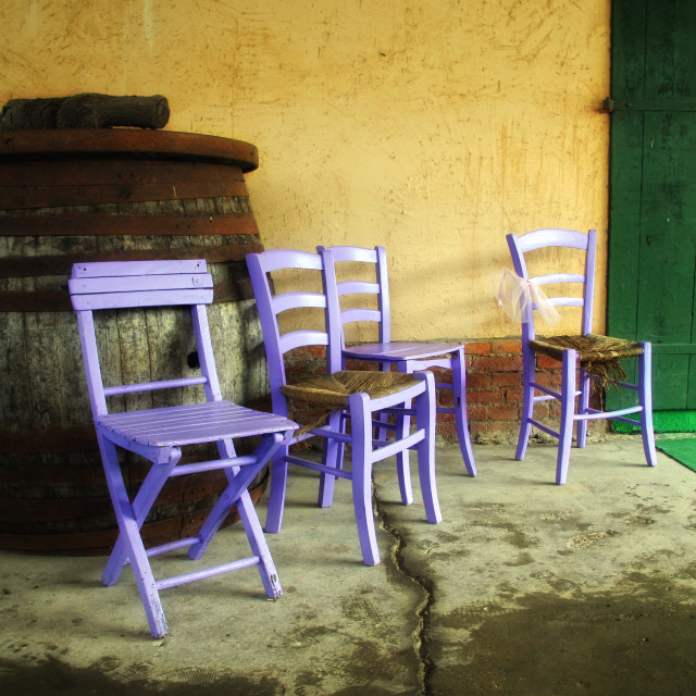 """""""Wooden chairs painted in pink, a yellow wall and a green door"""" stock image"""