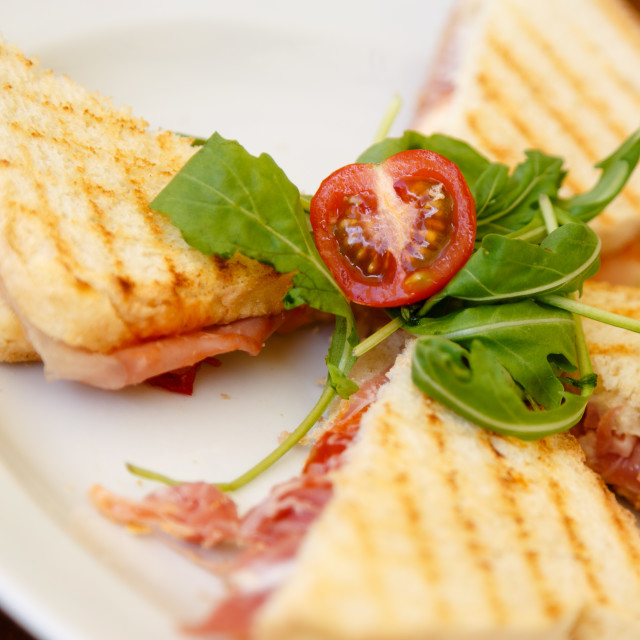 """""""Baked toasts with prosciutto, arugula and baby tomato"""" stock image"""