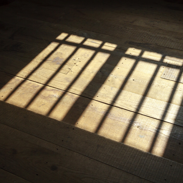 """Sunlight on wooden floor"" stock image"