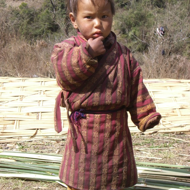 """Bhutanese toddler in field"" stock image"