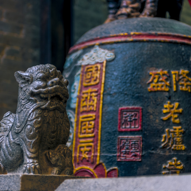 """The Statue of Rocky Lion and The Antique Bell in Pagoda"" stock image"