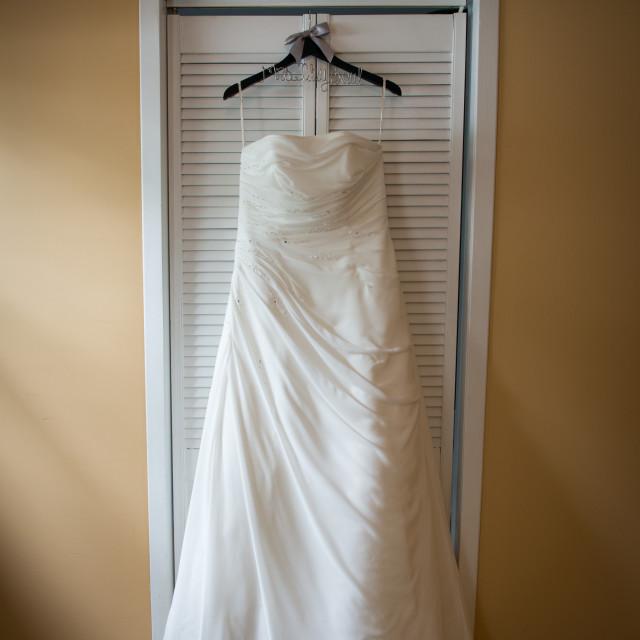 """Wedding dress on hangar"" stock image"