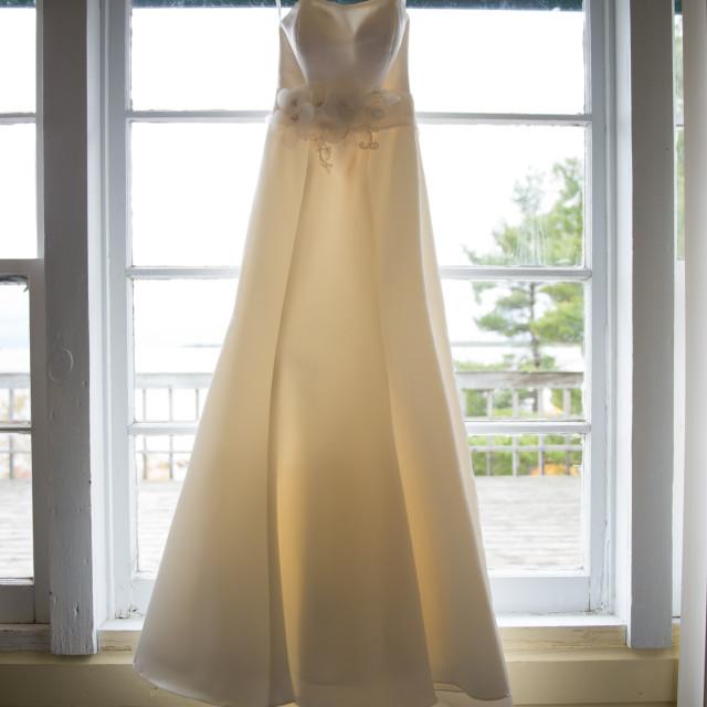 """Wedding Dress in Window"" stock image"