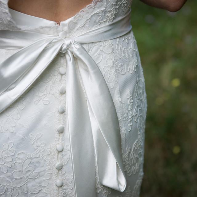 """Back of bride's wedding dress"" stock image"