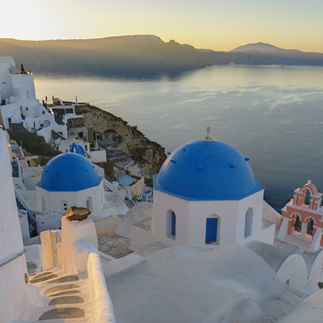 """Blue Domes Santorini at Sunrise"" stock image"