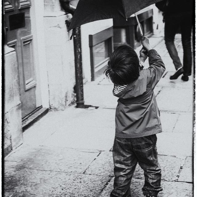 """Boy with his umbrella"" stock image"