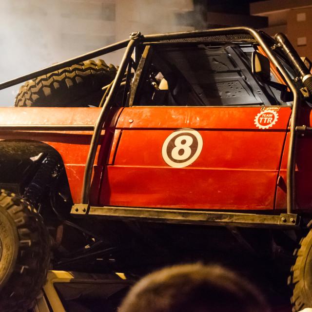 """4x4 vehicle crushes old cars."" stock image"