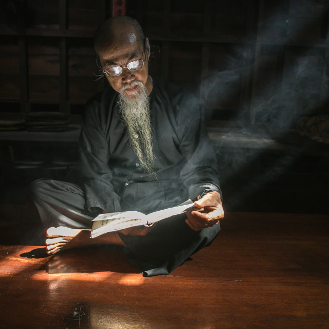 """""""a calligraphy men reading book at Long Son"""" stock image"""
