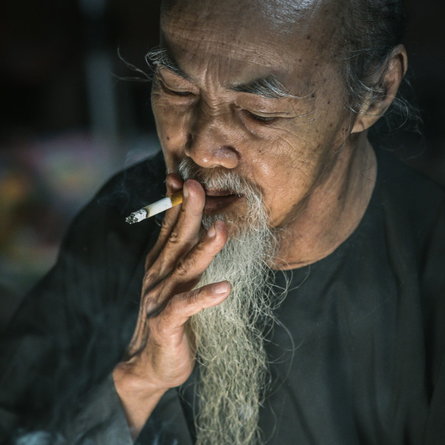 """a calligraphy men smoking at Long Son"" stock image"