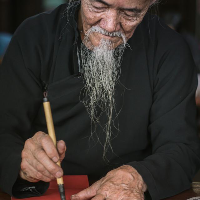 """Drawing calligraphy at Long Son"" stock image"
