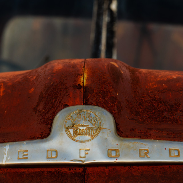 """Rusty Bedford truck (with shiny badge) in Coober Pedy, outback South Australia."" stock image"