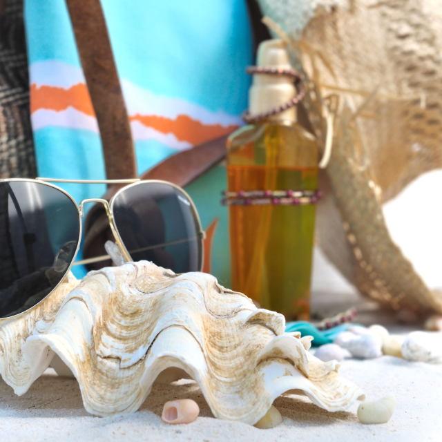 """sunglasses, shells and beach bag"" stock image"