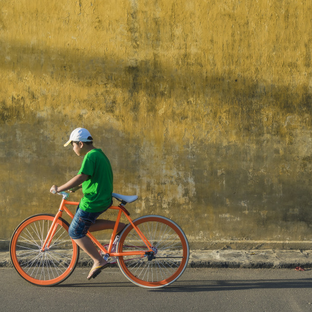 """Asian boy enjoys his fixed bike on the road"" stock image"