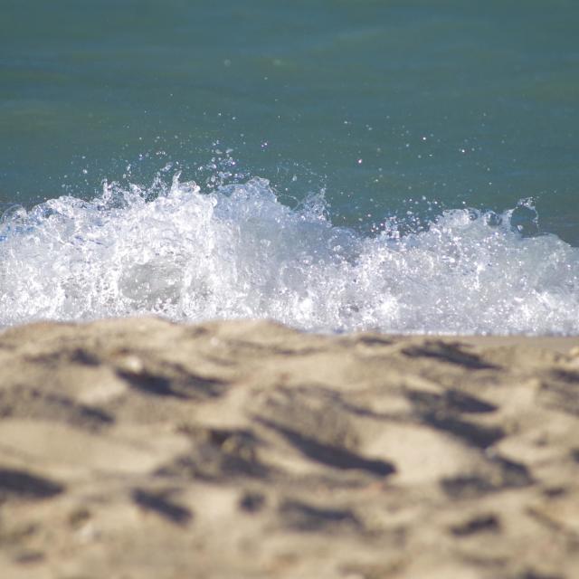"""""""Wave crashing onto beach"""" stock image"""