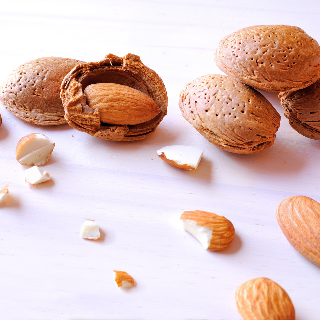 """""""Group fo almonds on a white table top view"""" stock image"""