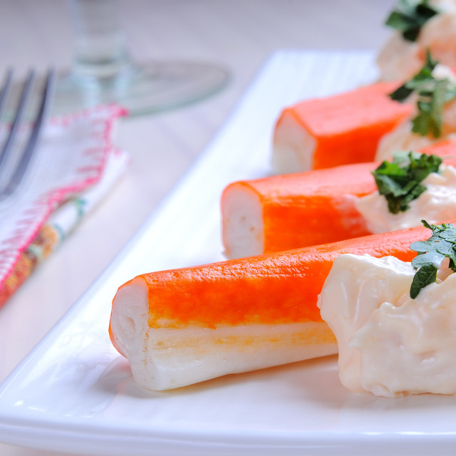 """Surimi sticks with sauce on a white plate"" stock image"