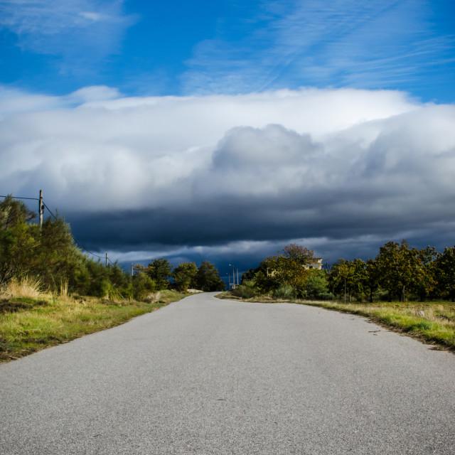 """Rural road toward the storm."" stock image"