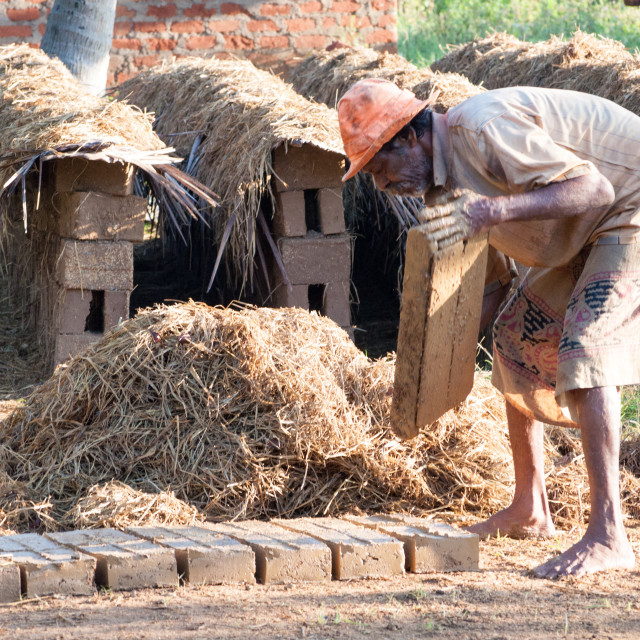 """Mud bricks maker"" stock image"