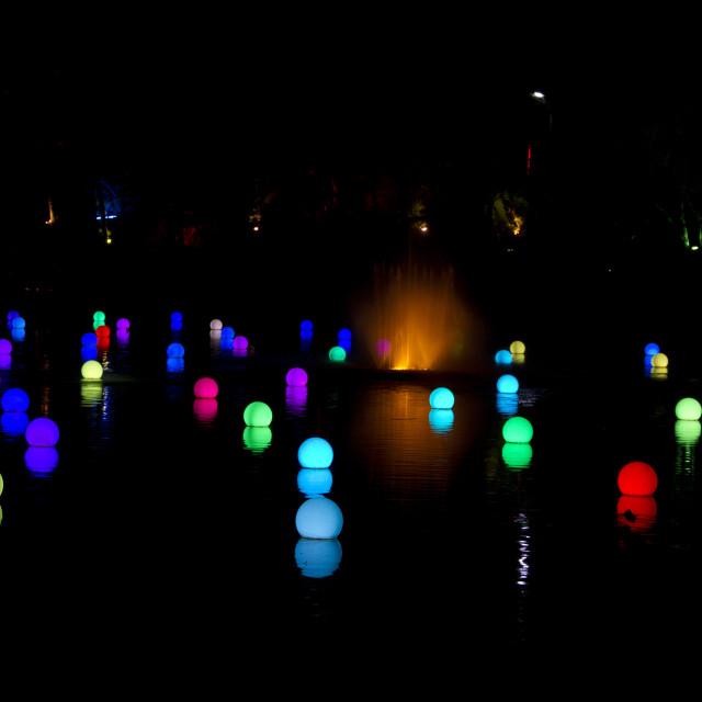"""Coloured lights on lake"" stock image"