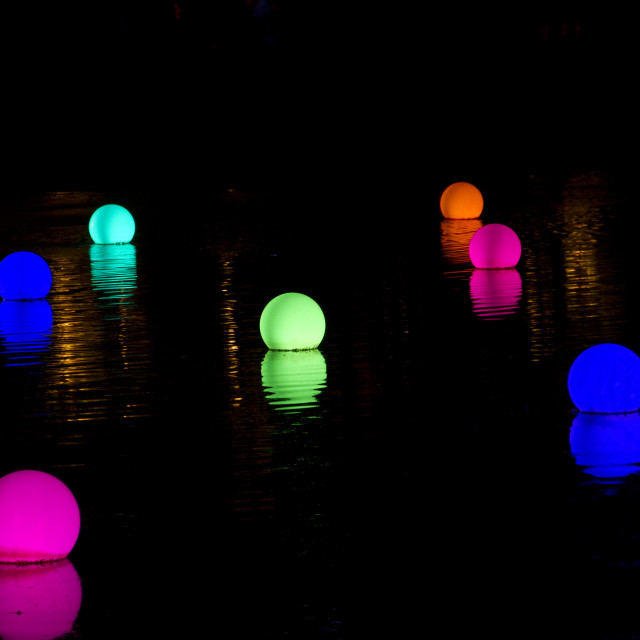 """Coloured lights on water"" stock image"