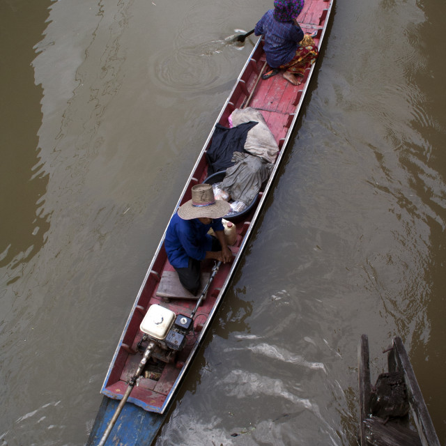"""man ride in long-tailed boat along canal"" stock image"
