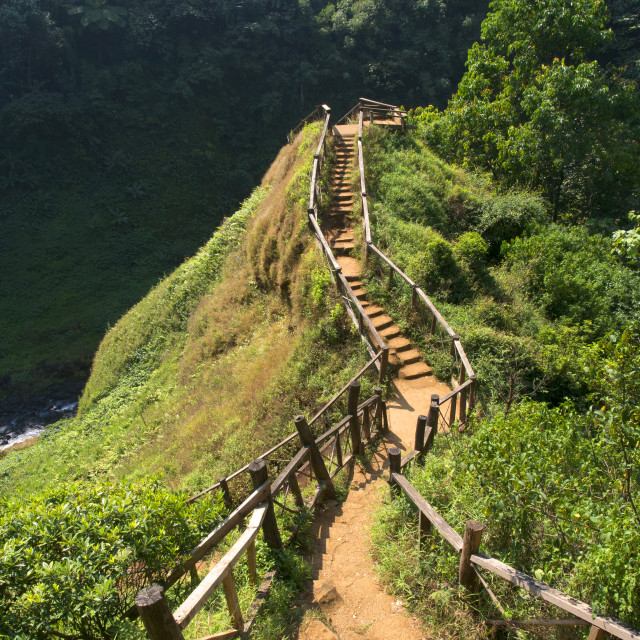 """stairs up the hill to waterfall view point in laos"" stock image"
