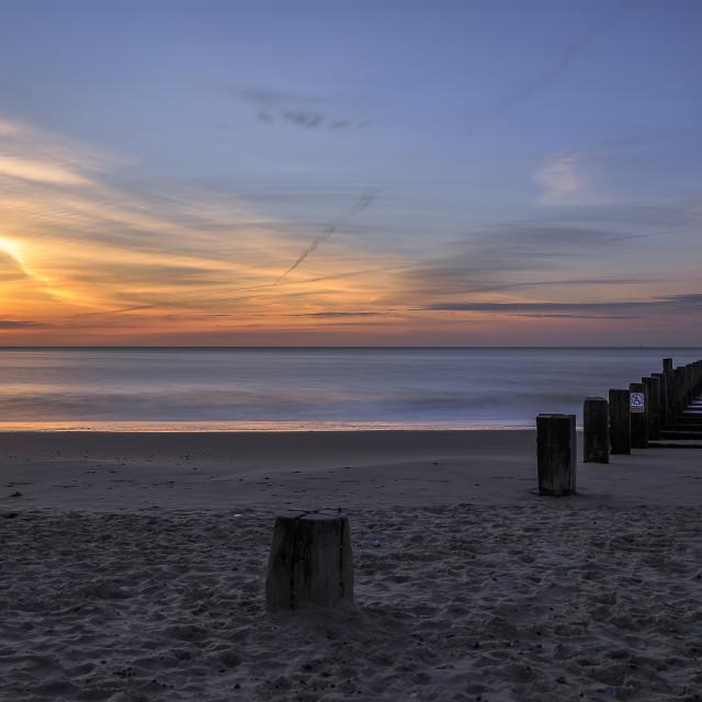 """Sunrise Over a Still Sea"" stock image"