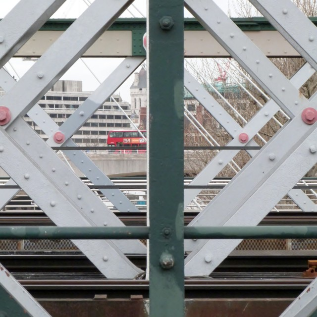 """""""London Bus viewed through Bridge"""" stock image"""