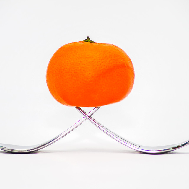 """Balancing Orange"" stock image"