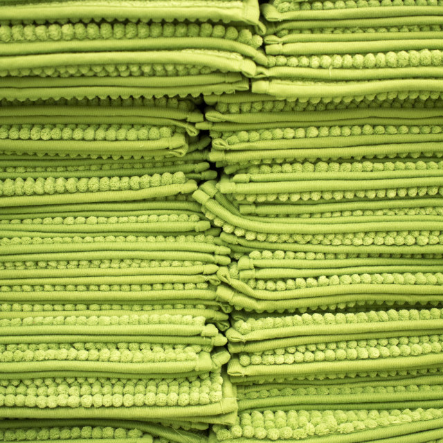 """stack of green rugs"" stock image"