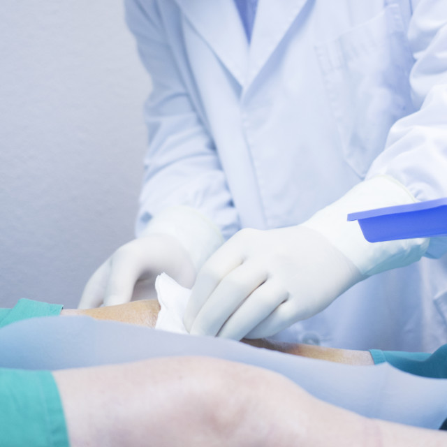 """""""Surgeon doctor injecting patient in hospital clinic PRP"""" stock image"""
