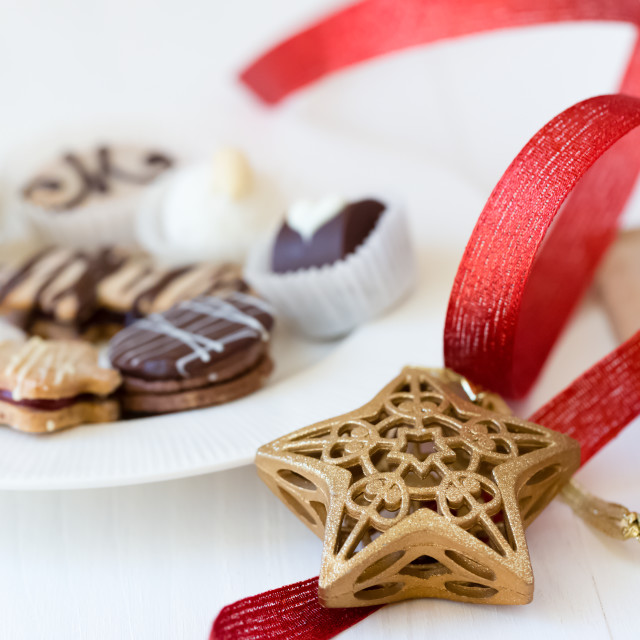 """""""Christmas cookies on a plate with decorations and a red ribbon"""" stock image"""