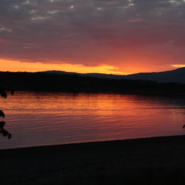 """Sunset over Scottish loch"" stock image"