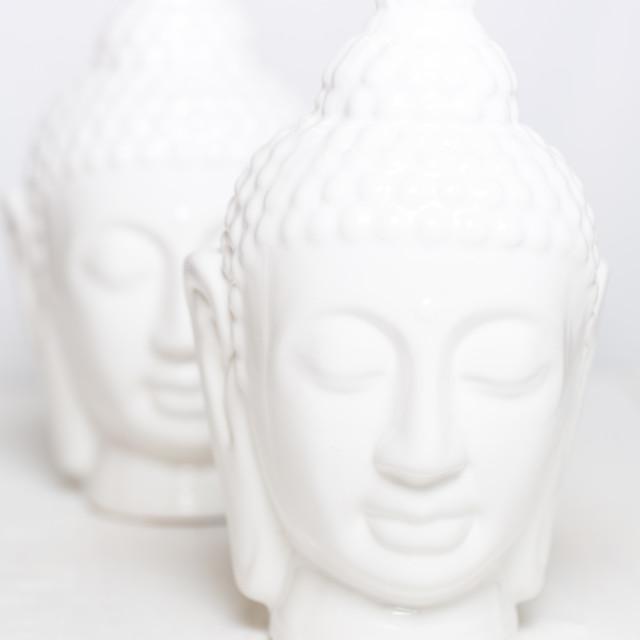 """Two decorative white statues of Buddha"" stock image"