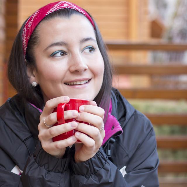 """Woman driking coffee at nature"" stock image"