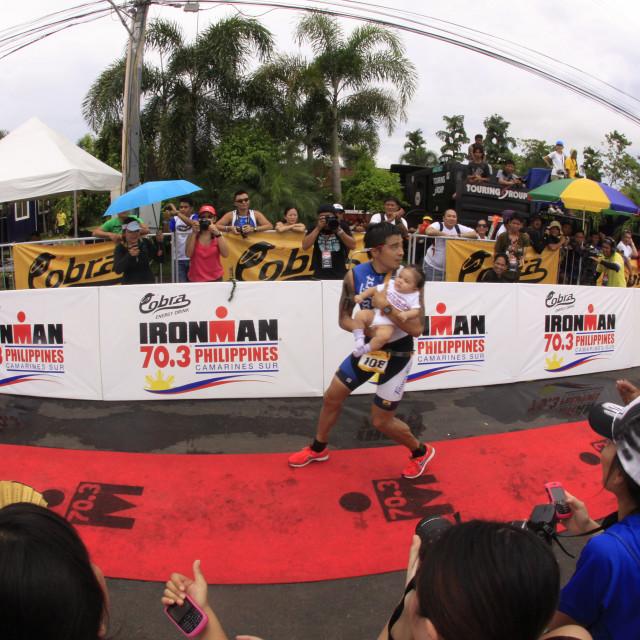 """""""Ironman Philippines marathon run race finish"""" stock image"""