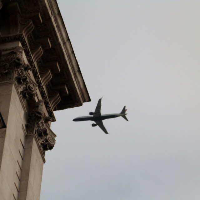 """""""Aeroplane in the City of London"""" stock image"""