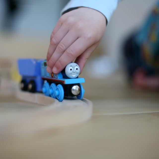 """""""Boy Pushes Train"""" stock image"""