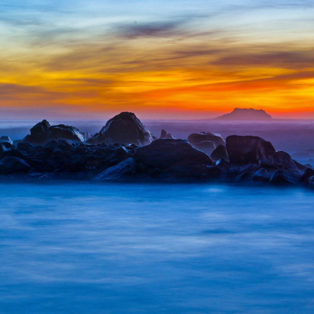"""Sunset rocks in Ocean"" stock image"