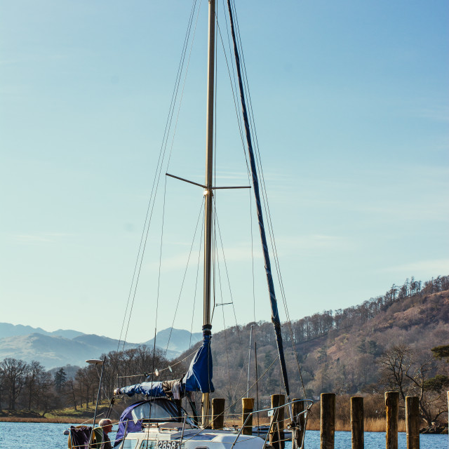 """Yacht At Lakeside Pier"" stock image"