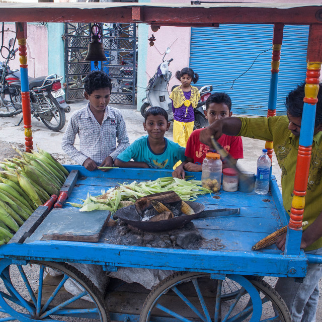 """Indian kids buying roasted corn."" stock image"