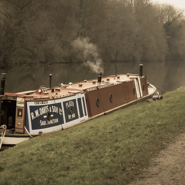 """A Dog Stands Guard Alongside A Narrowboat"" stock image"