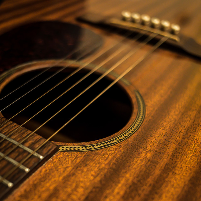 """Close up of Mahogany Martin Acoustic Guitar - Diagonal Lines"" stock image"
