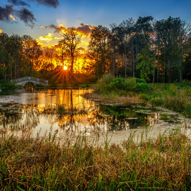 """Autumn Sunset Over The Middle Pond"" stock image"