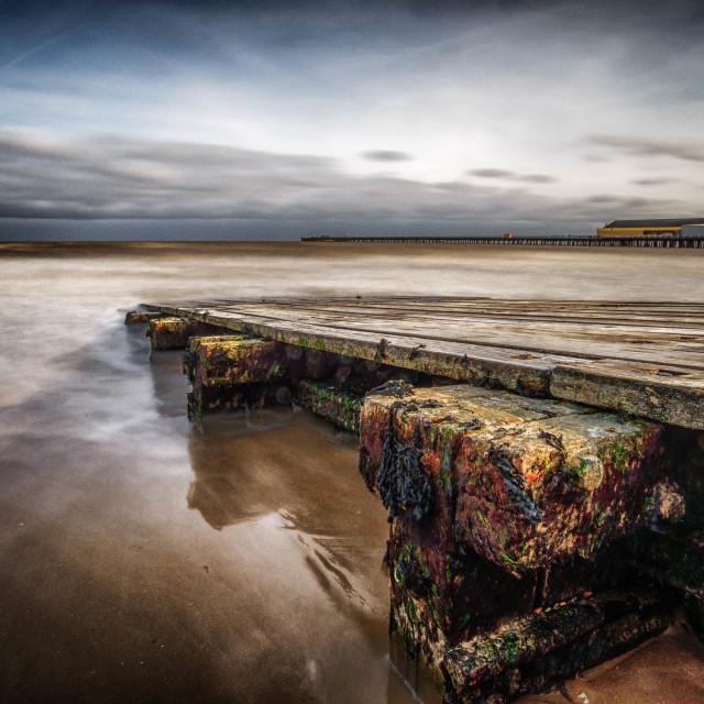"""Approaching tide at Walton Beach"" stock image"