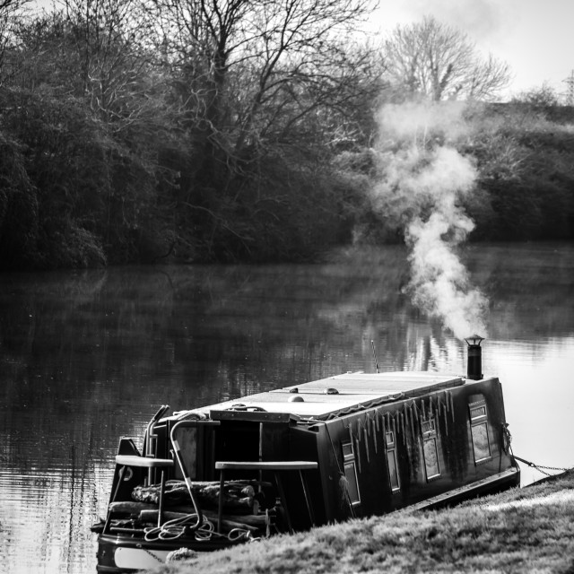 """A narrowboat moored up in winter"" stock image"