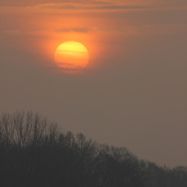 """Sunrise on a misty morning"" stock image"