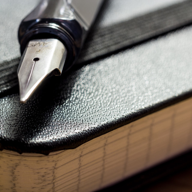 """Moleskine & Fountain Pen"" stock image"