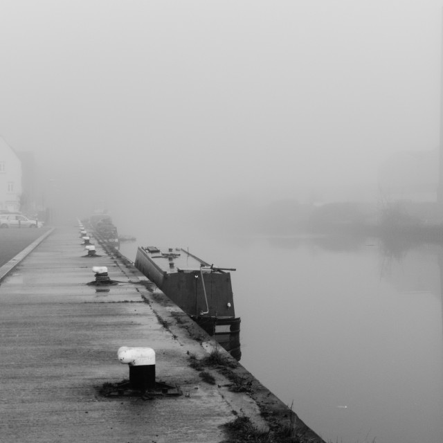 """A Narrowboat Moored in the Mist"" stock image"