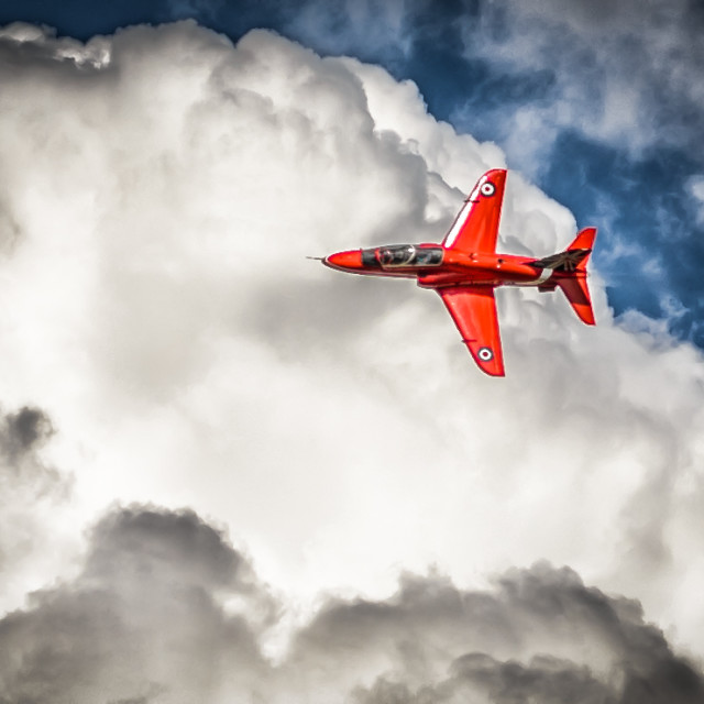 """""""Red Arrow In Action Over the Clouds"""" stock image"""
